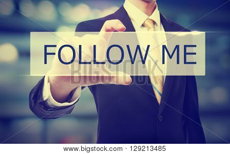 Business Man Holding Follow Me
