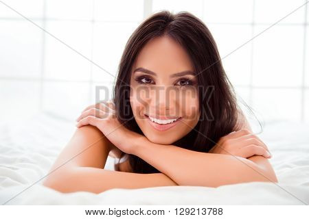 Pretty Woman With Beaming Smile Relaxing And Lying In Bed