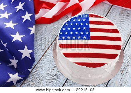 American flag cake on wooden background. President's day concept.