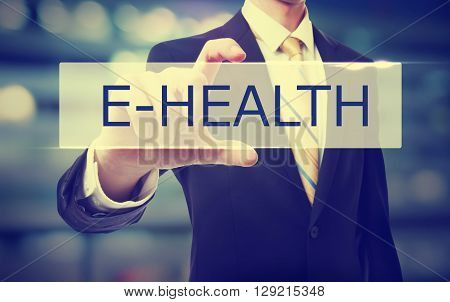 Business man holding E-Health on blurred abstract background
