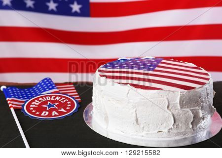 American flag cake, on black wooden background. President's day concept.