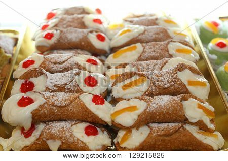 Sicilian Cannoli With Custard And Cherries Or Candied Fruit