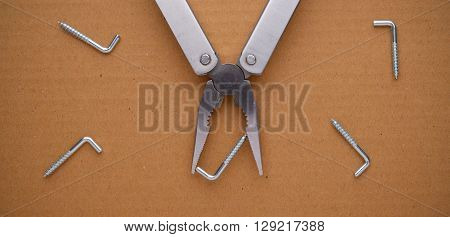 Multitool on cardboard. A tool for a variety of cases.