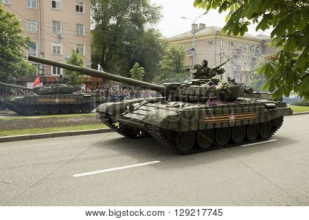 Donestk, Donetsk People Republic, Ukraine - 2016, May 9: Armored tanks T-72 driving through the main street of the Donetsk city during Victoty Parade. 2016, May 9.