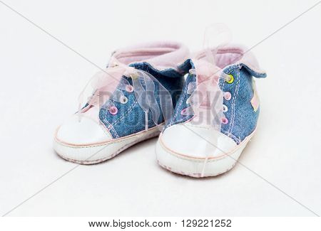 Pair of blue and white baby shoes not isolated