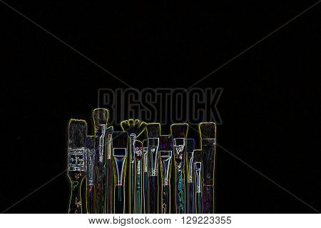 Neon outline of paintbrushes with black background