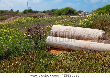 Two old ruined pillars at Caesarea, Israel.