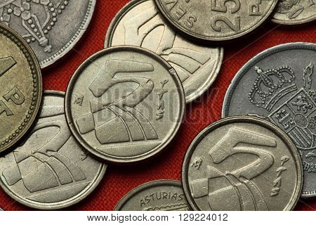 Coins of Spain. Stylized sailboats depicted in the Spanish five peseta coins (1992).