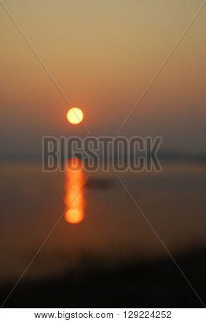 Beautiful view shadows Light Long-tailed boat sunrise in dam Srinakarin National park Kanchanaburi Thailand