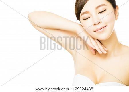Young beautiful woman with perfect skin and armpit care
