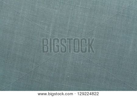 Pale blue textile texture. Pale blue background.