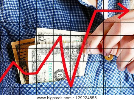 Business accounting concept. Money in cotton shirt pocket, close up