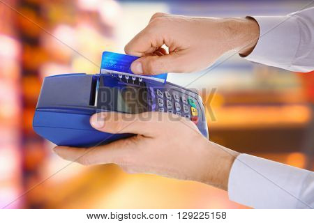 Credit card payment. Businessman using payment terminal