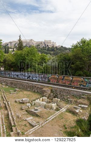 Metro train-line through Athens Ancient Agora with Acropolis in the background. Photo taken in spring 2016
