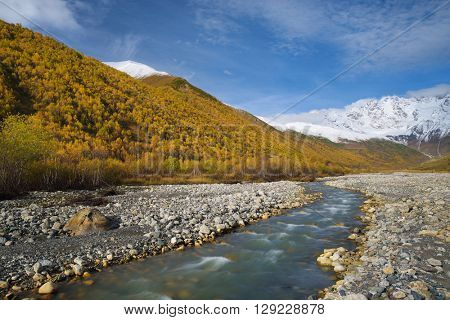 Mountain River. Autumn landscape. Inguri River. Mountain Shkhara. Caucasus, Georgia, Zemo Svaneti