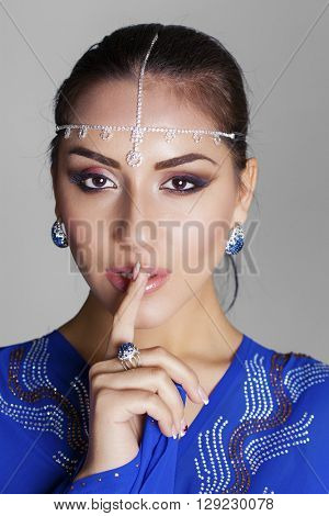 Portrait of attractive girl with finger on lips, concept of student show quiet, silence, secret gesture, young pretty brunette woman