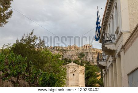 Athens, Plaka District View With Flag, Roman Agora And Acropolis In The Background