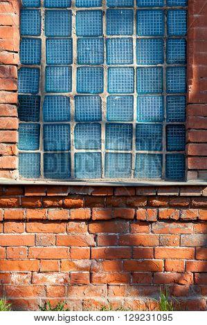 Old European window filled with broken glass blocks, Russian