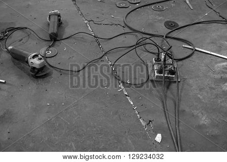 old grinding machine on rubber floor used in the factory