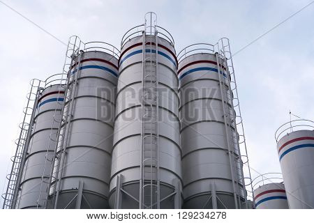 Tank of industrial process with sky background.