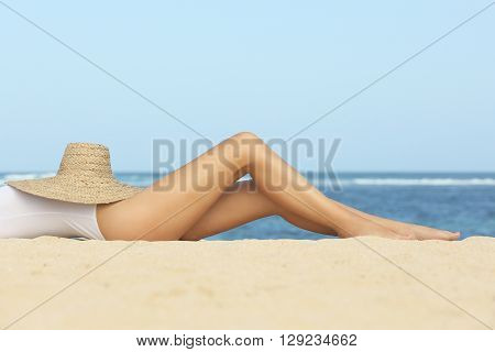 Girl on the beach - legs close up