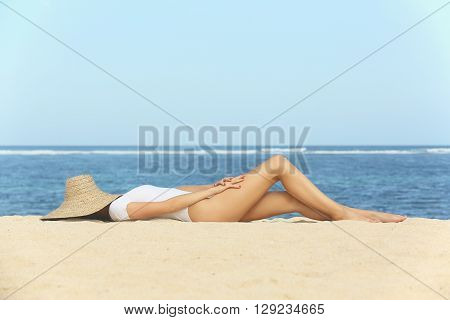 Girl on the beach - laying on the sand