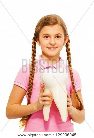 Cute teenager, student or schoolgirl, holding tooth dummy in her hands, isolated on white