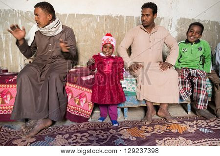 ASWAN, EGYPT - FEBRUARY 7, 2016: Local family from Nubian village on the Nile in their home.