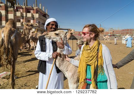 DARAW, EGYPT - FEBRUARY 6, 2016: Tourist and local camel salesmen at camel market.