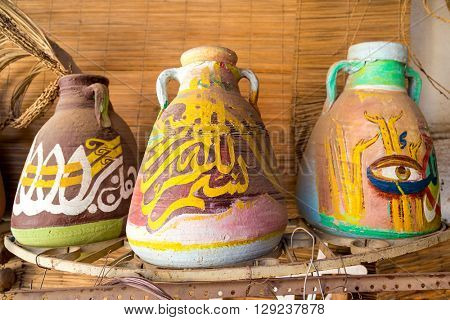 DARAW, EGYPT - FEBRUARY 6, 2016: Decorative colorful pottery in Palm tree decoration gallery.