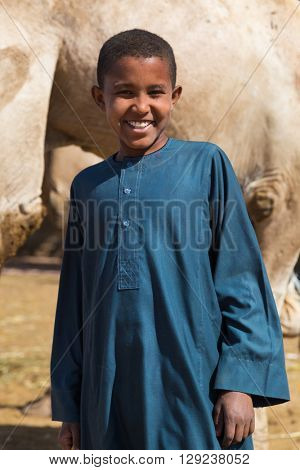 DARAW, EGYPT - FEBRUARY 6, 2016: Local young camel salesmen on Camel market posing for camera.