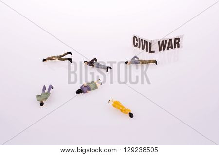 Human Figures near torn Newspaper Title on white background