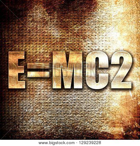 e = mc2, rust writing on a grunge background