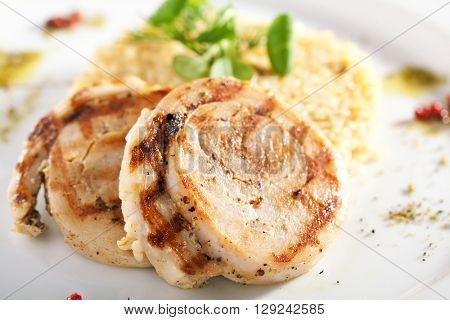 Pork Medallions with Rice and Basil Leaf
