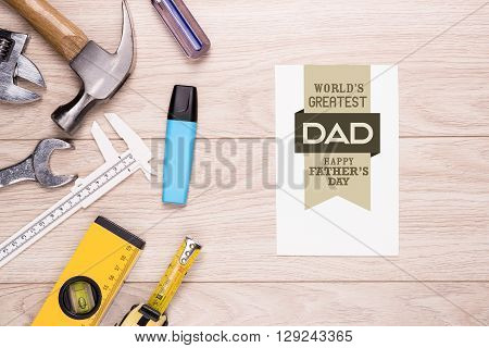 Happy Fathers Day Greeting Card with corner border of tools and ties on a rustic wood background