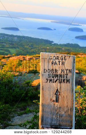 Trail guide sign at Acadia National Park for Gorge Path and Dorr Mountain Summit