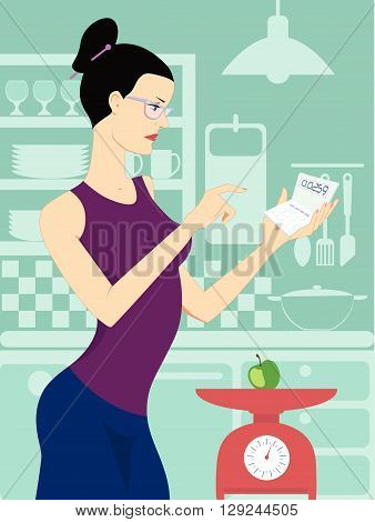Diet. Woman weighing an apple on a kitchen scale and calculating calories on a calculator in her kitchen.