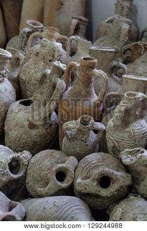Group of ancient clay amphoras found underground.