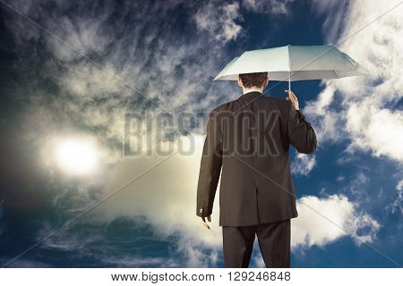 Busines man holding umbrella business concept in color