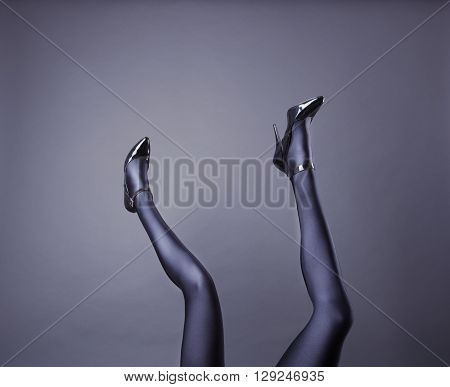 Woman's Legs Wearing Spandex Pantyhose and High Heels with space for text