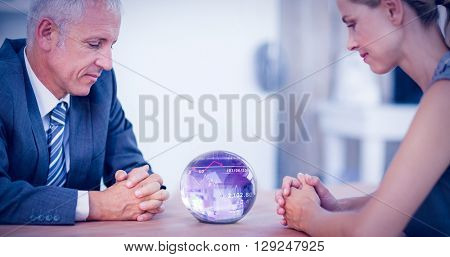 Stocks and shares against two business people thinking with a crystal ball