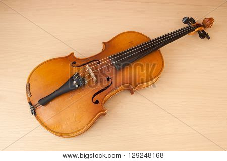 Old violin music concept lying on wood desk