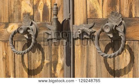 Gothic Wrought Iron Elements On The Wooden Plank Gate