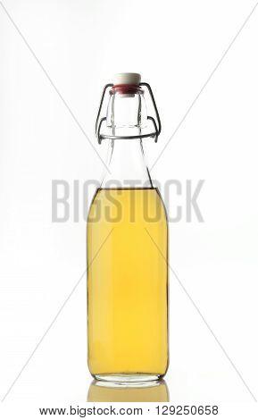 High resolution image of apple cider vinegar shot in studio on white background