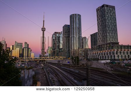 TORONTO CANADA - 8TH OCTOBER 2013: Part of downtown Toronto at sunset. Condominium the CN Tower office buildings and train tracks can be seen.