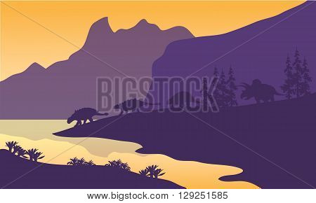 Ankylosaurus family of silhouette in the lake
