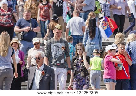 Young People And Older People With St. George Ribbons In The Crowd At The Celebration Of Victory Day