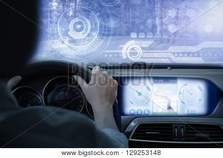 Technology interface against businesswoman sitting in drivers seat