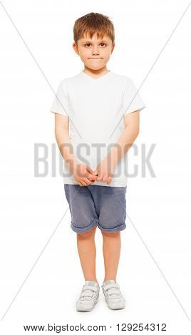 Whole-length picture of little boy wearing blank white t-shirt and denim shorts, isolated on white background