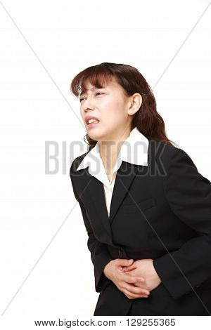 Asian businesswoman suffers from stomachache on white background